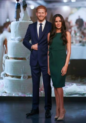 Wax figures of Britain's Prince Harry and his US fiancee Meghan Markle are at Madame Tussauds in central London