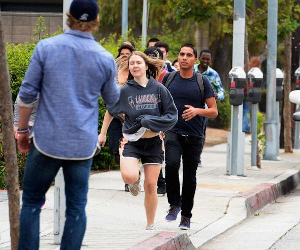 PHOTO:Students rush to safety after shots were fired near the Santa Monica College, June 7, 2013, in Santa Monica, Calif. (Kevork Djansezian/Getty Images)