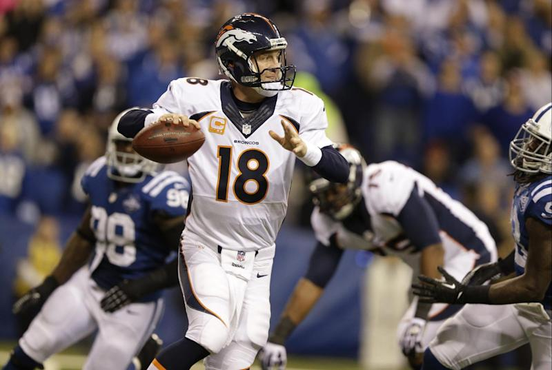 Denver Broncos quarterback Peyton Manning (18) scrambles during the second half of an NFL football game against the Indianapolis Colts, Sunday, Oct. 20, 2013, in Indianapolis. (AP Photo/Michael Conroy)