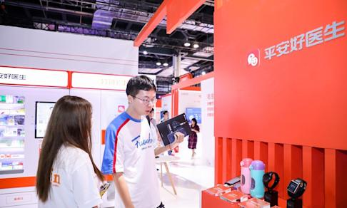 Visitors to the World Artificial Intelligence Conference in Shanghai gaze at smart gadgets displayed by Ping An Good Doctor on August 29, 2019. Photo: SCMP