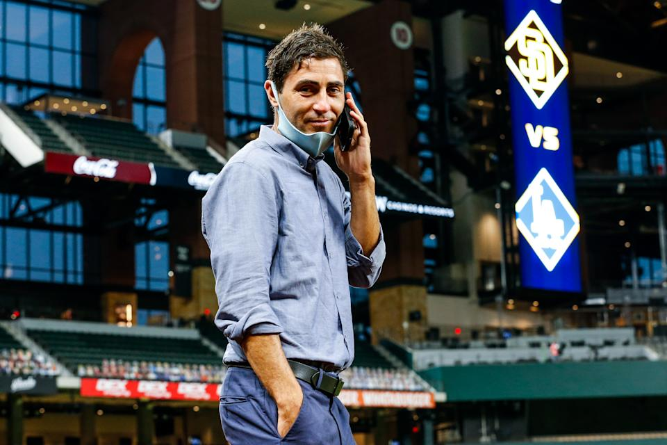 Padres GM A.J. Preller, seen here in Texas during San Diego's NLDS matchup with the Dodgers, is aggressively pursuing more stars.
