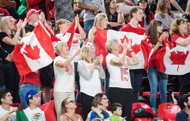 Fans cheer for Canada's Rosie MacLennan after she won the gold medal in the trampoline gymnastics competition at the 2016 Olympics in Rio de Janeiro. (Ryan Remiorz/Canadian Press - image credit)