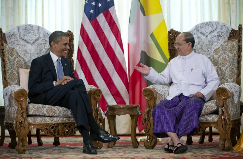 FILE - In this Nov. 19, 2012 file photo, U.S. President Barack Obama, left, meets with Myanmar's President Thein Sein at the Yangon Parliament building in Yangon, Myanmar. The United States is unwinding two decades of sanctions against Myanmar, as the country's reformist leadership oversees rapid-fire economic and political change. Obama's visit this week, the first by a serving U.S. president, is a sign of how far relations have come. But Washington continues to take a calibrated approach to easing sanctions, keen to retain leverage should Myanmar's reform momentum stall. (AP Photo/Carolyn Kaster, File)
