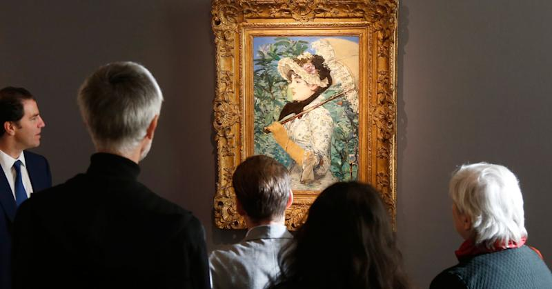 "Visitors look at the painting ""Le Printemps"", 1881, by French painter Edouard Manet during its presentation at Christie's Auction House in Paris October 22, 2014."