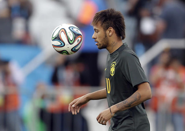 Brazil's Neymar heads the ball during an official training session the day before the group A World Cup soccer match between Brazil and Croatia in the Itaquerao Stadium, Sao Paulo , Brazil, Wednesday, June 11, 2014. (AP Photo/Andre Penner)