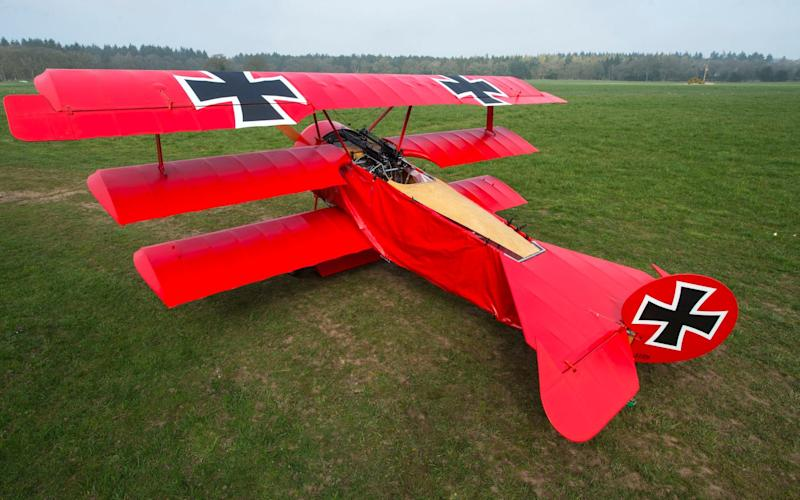 A German GP based in Norfolk has spent 8 years building a Fokker triplane in his garage as a tribute to infamous WW1 Ace Manfred von Ricthofen, who terrorised the skies over the Western front during the first war - Credit: Phil Yeomans/BNPS