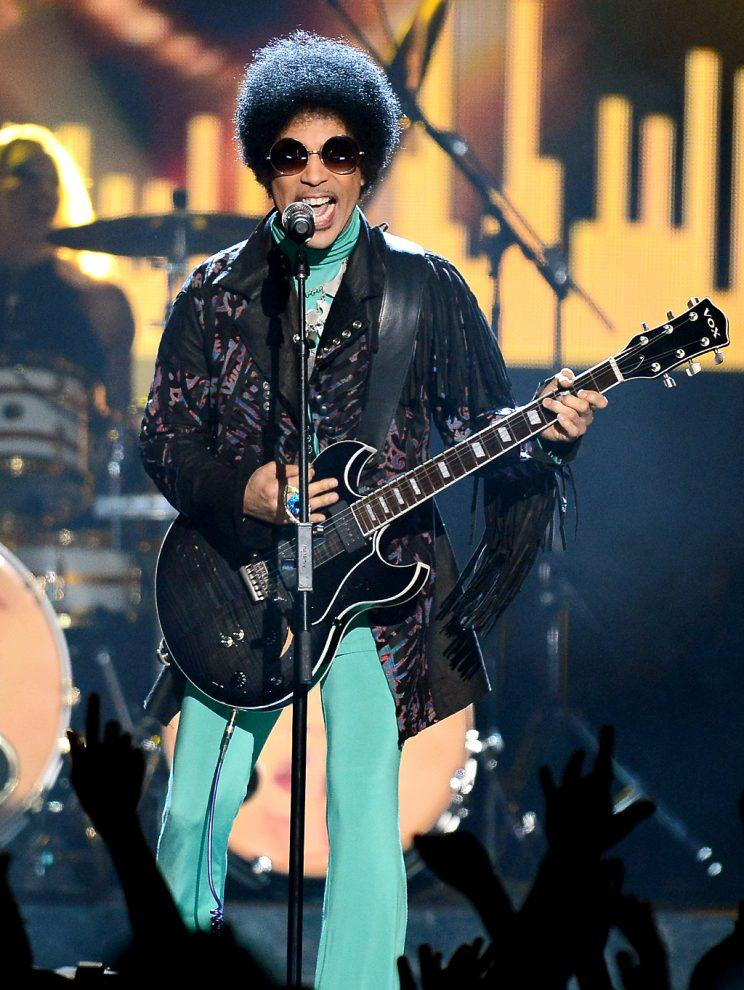 Prince performs during the 2013 Billboard Music Awards
