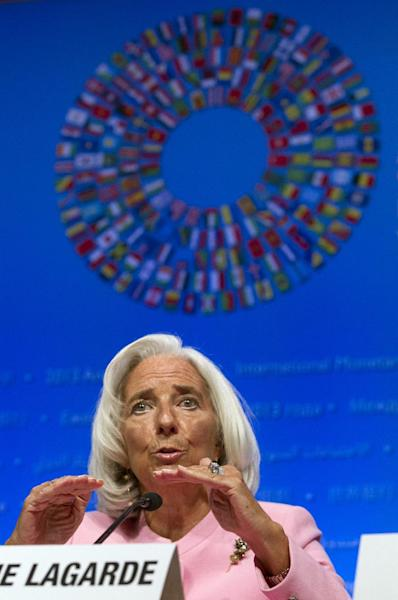 International Monetary Fund (IMF) Managing Director Christine Lagarde gestures while speaking at a news conference during the World Bank/IMF Annual Meetings at IMF headquarters in Washington, Thursday, Oct. 10, 2013. Lagarde said the global economy is in a slow and unbalanced recovery, and warned that US failure to raise the debt ceiling because of impasse over the government shutdown would seriously damage the American as well as the global economy. (AP Photo/Jose Luis Magana)