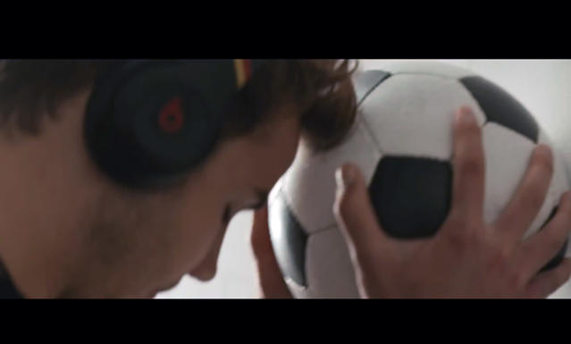 This frame grab shows a scene in an ad for Beats by Dr. Dre stereo headphones. Beats Electronics, recently acquired by Apple for $3 billion, is not an official sponsor of the World Cup, but the company's new advertisement associates the brand with the event. (AP Photo)