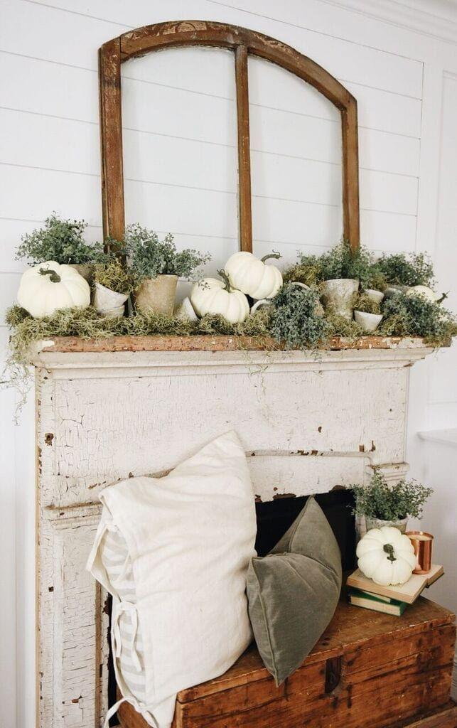 """<p>This polished mantel décor is easier to create than you'd think. You just need some moss, a few vintage-looking planters, and white pumpkins to weave it all together. </p><p><strong>Get the tutorial at <a href=""""https://www.lizmarieblog.com/2017/08/rustic-garden-fall-mantel/"""" rel=""""nofollow noopener"""" target=""""_blank"""" data-ylk=""""slk:Liz Marie"""" class=""""link rapid-noclick-resp"""">Liz Marie</a>.</strong></p><p><a class=""""link rapid-noclick-resp"""" href=""""https://go.redirectingat.com?id=74968X1596630&url=https%3A%2F%2Fwww.walmart.com%2Fip%2FForest-Moss-Dried-4oz%2F634912898&sref=https%3A%2F%2Fwww.thepioneerwoman.com%2Fhome-lifestyle%2Fcrafts-diy%2Fg36891743%2Ffall-mantel-decorations%2F"""" rel=""""nofollow noopener"""" target=""""_blank"""" data-ylk=""""slk:SHOP MOSS"""">SHOP MOSS</a></p>"""