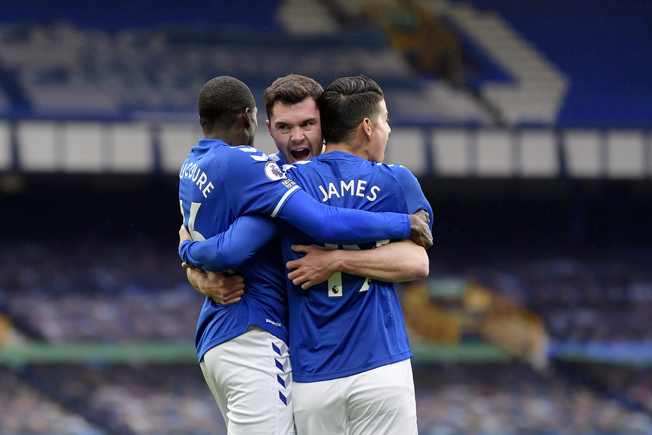 LIVERPOOL, ENGLAND - OCTOBER 17:  Michael Keane  (C) of Everton celebrates his goal with James Rodriguez and Abdoulaye Doucoure (L) during the Premier League match between Everton and Liverpool at Goodison Park on October 17 2020 in Liverpool, England. (Photo by Tony McArdle/Everton FC via Getty Images)