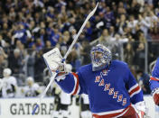 FILE - In this Friday, April 24, 2015, file photo, New York Rangers goalie Henrik Lundqvist (30) celebrates after Game 5 against the Pittsburgh Penguins in the first round of the NHL hockey Stanley Cup playoffs in New York. The Rangers won 2-1. The New York Rangers have bought out the contract of star goaltender Henrik Lundqvist. The Rangers parted with one of the greatest netminders in franchise history on Wednesday, Sept. 30, 2020, when they paid off the final year of his contract. (AP Photo/Frank Franklin II, File)