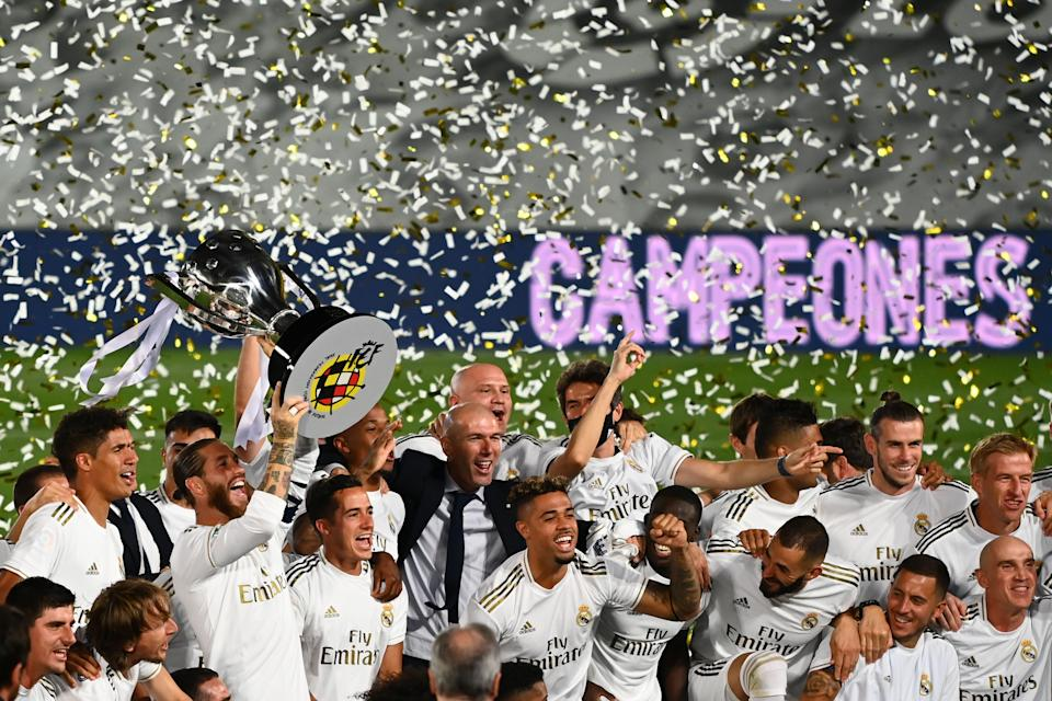 Real Madrid celebrates its La Liga crown after beating Villarreal 2-1 on Thursday. (Photo by GABRIEL BOUYS/AFP via Getty Images)