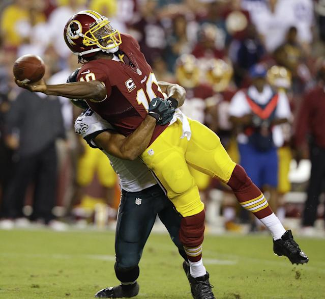 Washington Redskins quarterback Robert Griffin III (10) tries to get off a pass as he wrapped up by Philadelphia Eagles outside linebacker Mychal Kendricks during the first half of an NFL football game in Landover, Md., Monday, Sept. 9, 2013. (AP Photo/Alex Brandon)