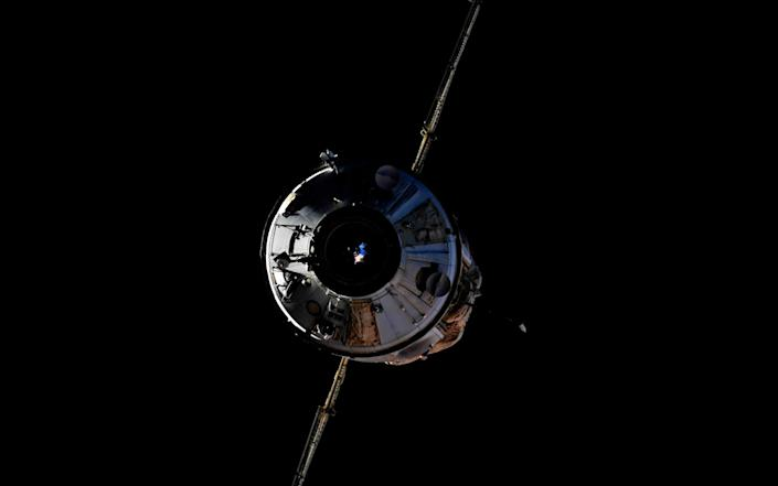 In this photo taken by Russian cosmonaut Oleg Novitsky, the Nauka module is seen prior to docking with the International Space Station on Thursday - Roscosmos Space Agency Press Service