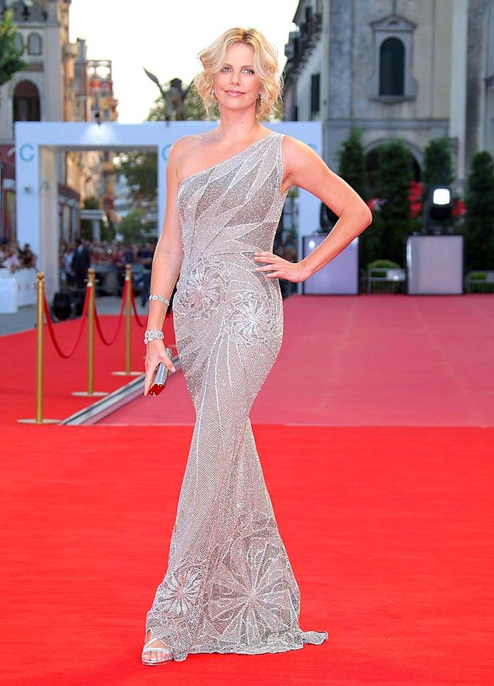 "Charlize Theron sparkled in a silver Versace gown at the 65th annual Venice Film Festival. Daniele Venturelli/<a href=""http://www.wireimage.com"" target=""new"">WireImage.com</a> - August 29, 2008"