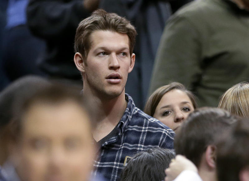 FILE - This Jan. 7, 2014 file photo shows Los Angeles Dodgers pitcher Clayton Kershaw at the end of an NBA basketball game between the Los Angeles Lakers and Dallas Mavericks in Dallas. A person familiar with the deal says Kershaw has agreed to a $215 million, seven-year contract with the Dodgers, a deal that makes the two-time Cy Young Award winner baseball's first player with a $30 million average salary. The person spoke on condition of anonymity Wednesday, Jan. 15, 2014 because the agreement had not yet been announced. (AP Photo/Tony Gutierrez, File)