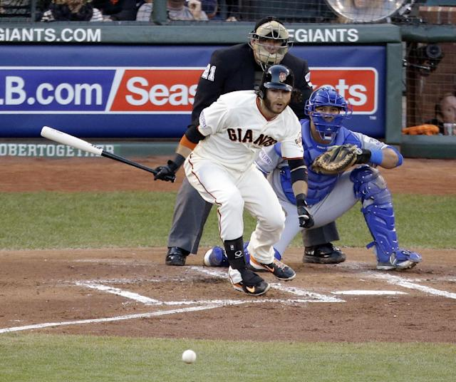 San Francisco Giants' Brandon Crawford hits a ground ball during the second inning of Game 5 of baseball's World Series Sunday, Oct. 26, 2014, in San Francisco. Hunter Pence scored on a fielder's choice. (AP Photo/Charlie Riedel)