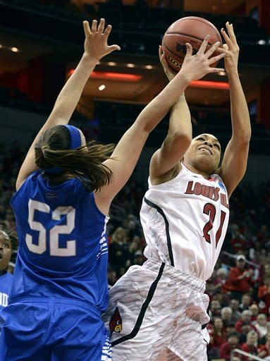Louisville's Bria Smith, right, puts a shot up over the defense of Middle Tennessee's Laken Leonard during the second half of a first-round game in the women's NCAA college basketball tournament in Louisville, Ky., Sunday, March 24, 2013. Louisville defeated Middle Tennessee 74-49. (AP Photo/Timothy D. Easley
