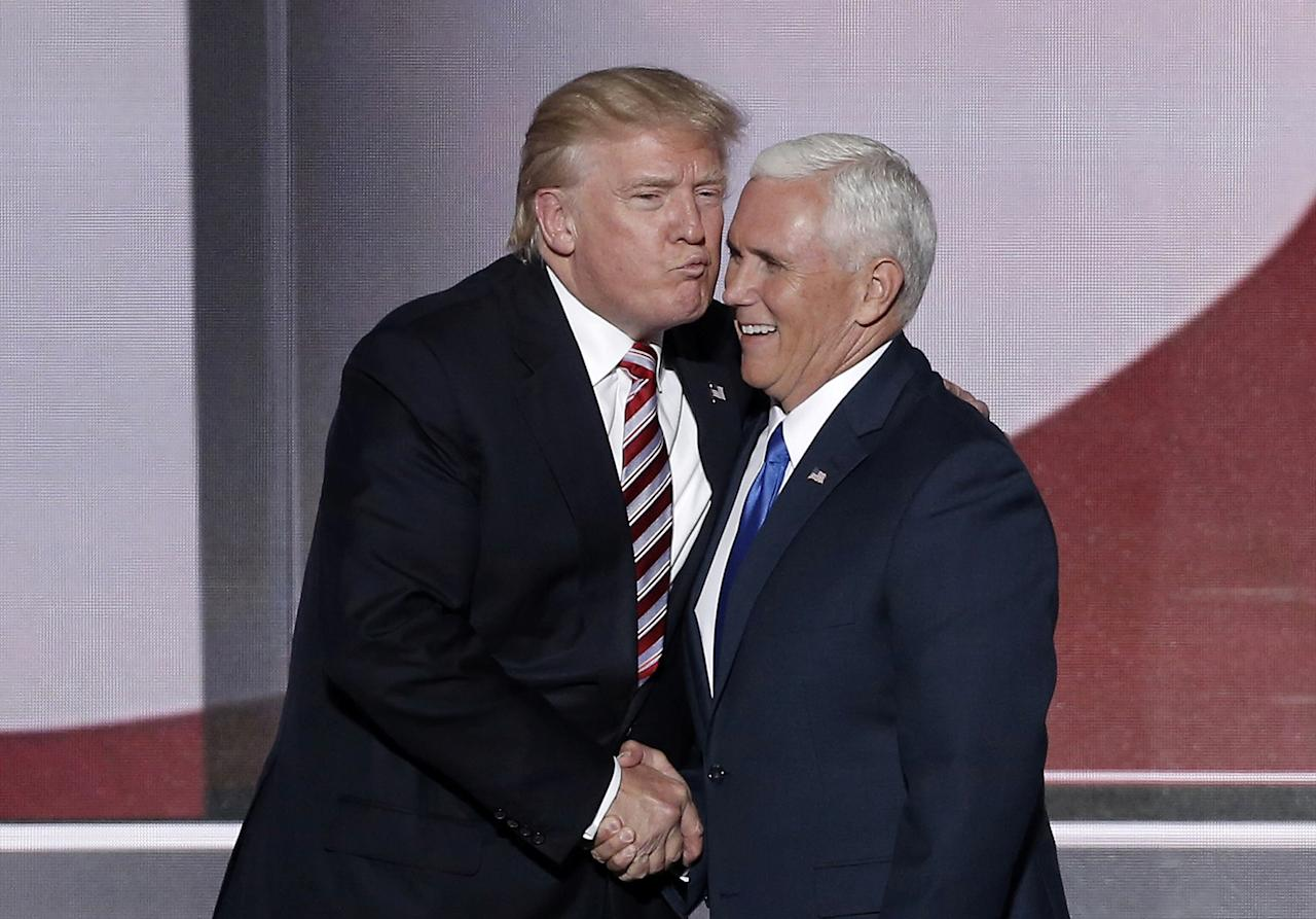 <p>Republican presidential nominee Donald Trump (L) greets vice presidential nominee Mike Pence after Pence spoke during the third day of the Republican National Convention in Cleveland, Ohio, July 20, 2016. (Photo: Mike Segar/Reuters) </p>