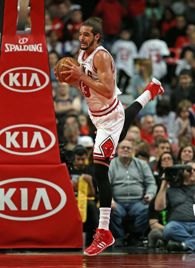 CHICAGO, IL - JANUARY 02: Joakim Noah #13 of the Chicago Bulls rebounds against the Boston Celtics at the United Center on January 2, 2014 in Chicago, Illinois. The Bulls defeated the Celtics 94-82. (Photo by Jonathan Daniel/Getty Images)