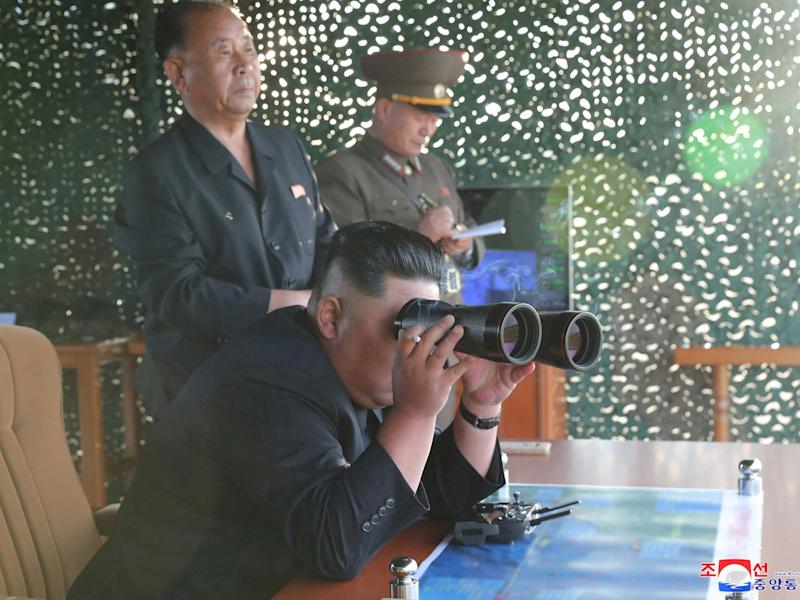 Kim Jong Un pictured watching the test of a multiple rocket launcher, according to state media: KCNA via Reuters
