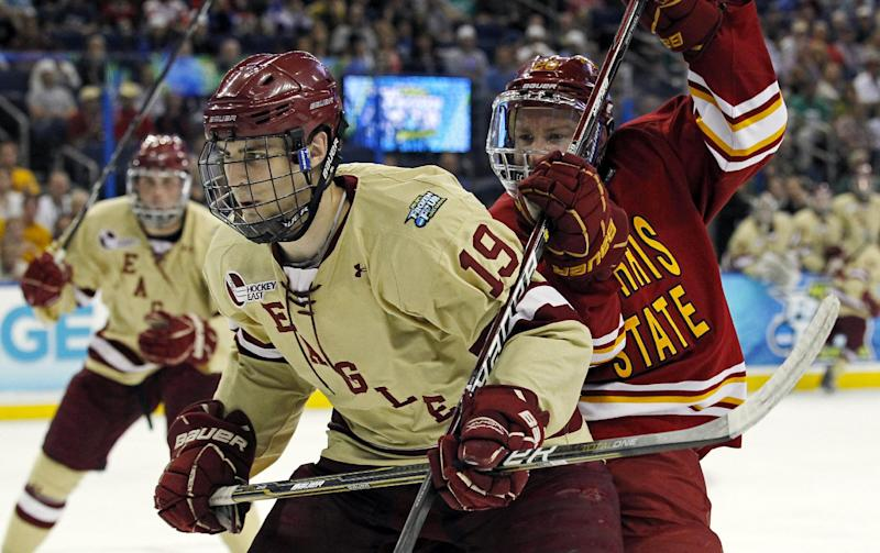 Boston College's Chris Kreider (19) and Ferris State's Matthew Kirzinger battle for the puck during the first period of the NCAA Frozen Four college hockey tournament final, Saturday, April 7, 2012, in Tampa, Fla. (AP Photo/Mike Carlson)