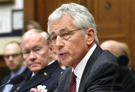 U.S. Secretary of Defense Chuck Hagel and Chairman of the Joint Chiefs of Staff U.S. Army General Martin Dempsey testify before the House Armed Services Committee hearing on on Capitol Hill in Washington