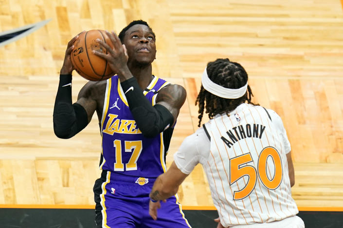 Los Angeles Lakers guard Dennis Schroder (17) looks for a shot against Orlando Magic guard Cole Anthony (50) during the first half of an NBA basketball game, Monday, April 26, 2021, in Orlando, Fla. (AP Photo/John Raoux)