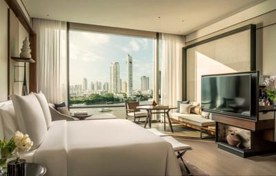 Guestrooms balance Thai touches and contemporary aesthetics with high ceilings and floor-to-ceiling windows