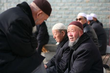 Men gather in a park in China's Linxia, Gansu province, home to a large population of ethnic minority Hui Muslims, February 1, 2018. Picture taken February 1, 2018. REUTERS/Michael Martina