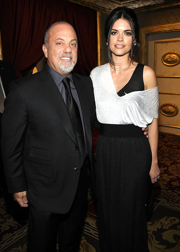 "The ""Piano Man"" is all smiles with his wife, former ""Top Chef"" host, Katie Lee Joel. Kevin Mazur/<a href=""http://www.wireimage.com"" target=""new"">WireImage.com</a> - March 10, 2008"