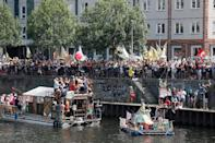 "One of the loudest counter-demos was organised by some 100 clubs from Berlin's legendary techno scene, who were using boats and floats on the river Spree and a convoy of DJ-carrying trucks to ""bass away"" the AfD (AFP Photo/Odd ANDERSEN)"