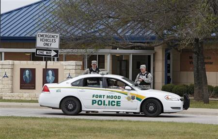 Fort Hood military police guard the visitor's center, after Wednesday's shooting, at the entrance to Fort Hood, Texas