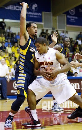 Marquette guard Trent Lockett, left, defends Southern California forward Eric Wise, right, in the first half of an NCAA college basketball game in the Maui Invitational, Wednesday, Nov. 21, 2012, in Lahaina, Hawaii. (AP Photo/Eugene Tanner)