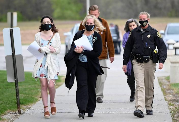 Jessica Runions' mother, Jamie Ruions, center, arrives at the Cass County Justice Center Friday, April 16, 2021, for the sentencing of Kylr Yust. Yust was found guilty by a jury Thursday of killing Jessica Runions and Kara Kopetsky.