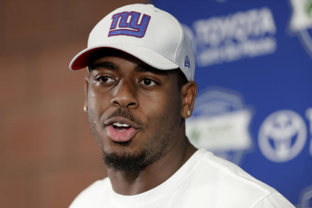 FILE - In this July 26, 2018, file photo, New York Giants linebacker Kareem Martin speaks to reporters during NFL football training camp in East Rutherford, N.J. The New York Giants released linebackers Alec Ogletree and Kareem Martin, clearing significant salary cap space Wednesday, Feb. 26, 2020, with the departure of their two most expensive defensive players.(AP Photo/Julio Cortez, File)