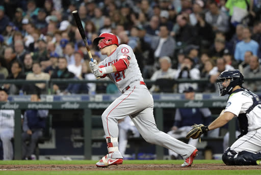 Los Angeles Angels' Mike Trout watches his solo home run against the Seattle Mariners during the fifth inning of a baseball game Tuesday, June 12, 2018, in Seattle. (AP Photo/Ted S. Warren)