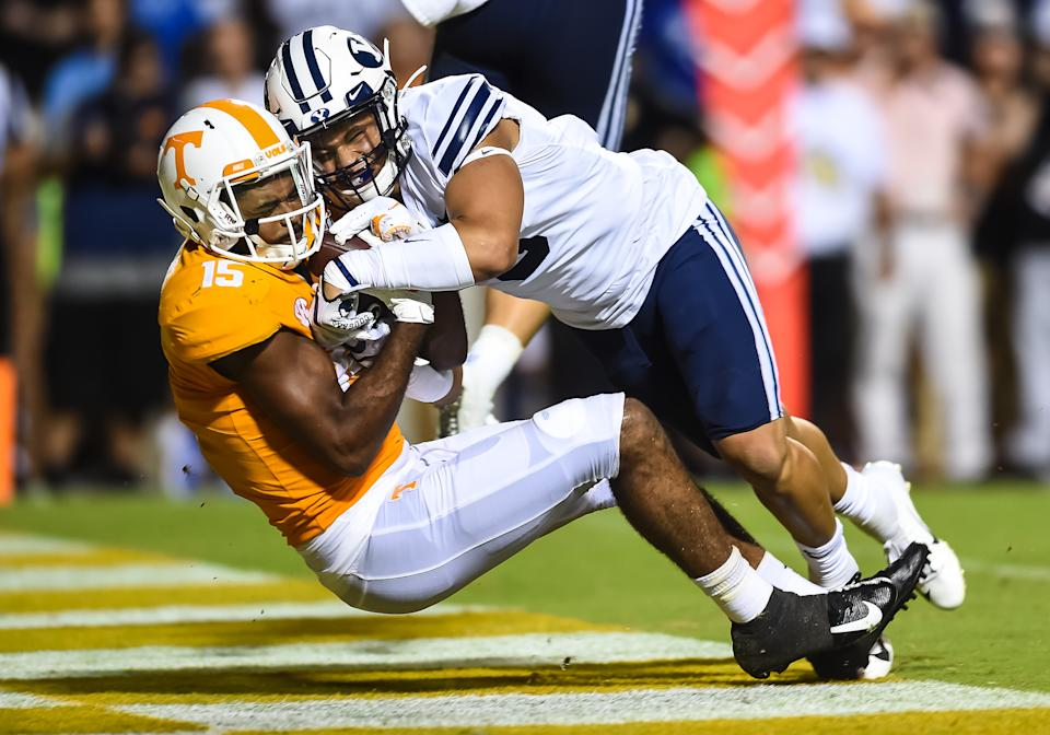 Tennessee Volunteers wide receiver Jauan Jennings (15) catches a pass while being guarded by Brigham Young Cougars linebacker Chaz Ah You (3) on Saturday. (Getty)