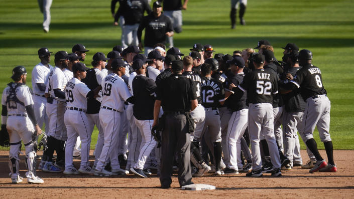 Detroit Tigers and Chicago White Sox benches clear in the ninth inning of a baseball game in Detroit, Monday, Sept. 27, 2021. (AP Photo/Paul Sancya)