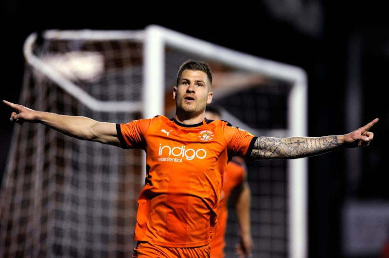 James Collins of Luton Town celebrates scoring his team's second goal during the Sky Bet League One match between Luton Town and AFC Wimbledon at Kenilworth Road.