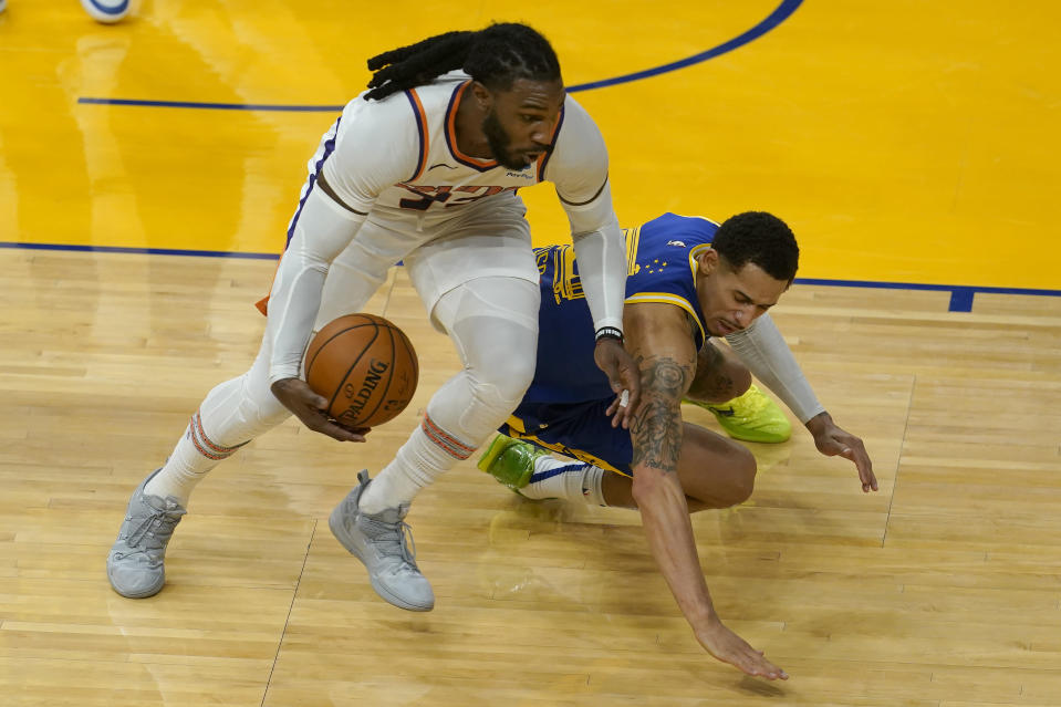 Phoenix Suns forward Jae Crowder, left, grabs the ball in front of Golden State Warriors forward Juan Toscano-Anderson during the first half of an NBA basketball game in San Francisco, Tuesday, May 11, 2021. (AP Photo/Jeff Chiu)