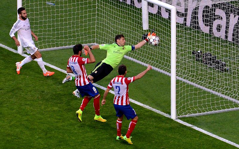 Iker Casillas of Real Madrid fails to stop the ball headed in by Diego Godin of Club Atletico de Madrid - Getty Images