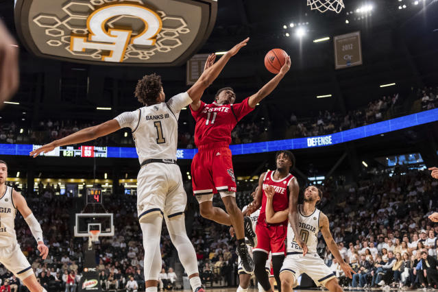 North Carolina State guard Dereon Seabron (1) shoots past Georgia Tech forward James Banks III (1) in the second half of an NCAA college basketball game Saturday, Jan. 25, 2020, in Atlanta. Georgia Tech won 64-58. (AP Photo/Danny Karnik)