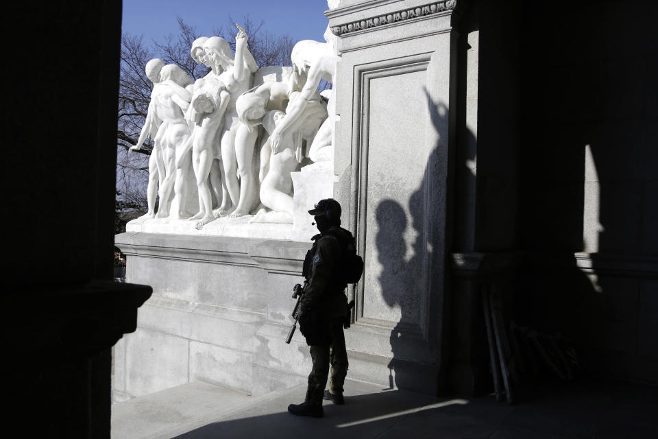 A Capitol police officer stands at the front entrance of the Pennsylvania Capitol building Tuesday Jan. 12, 2021, in Harrisburg, Pa. State capitols across the country are under heightened security after the siege of the U.S. Capitol last week. (AP Photo/Jacqueline Larma)