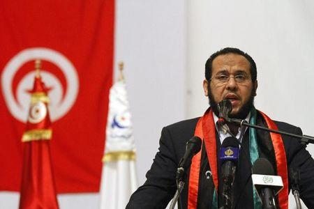 "Abdul Hakim Belhadj of Libya's Homeland party speaks during a demonstration at the Ennahda party ""Youth Festival"" organized by the Renaissance Movement at the Conference Palace in Tunis December 23, 2012. REUTERS/Anis Mili/File Photo"