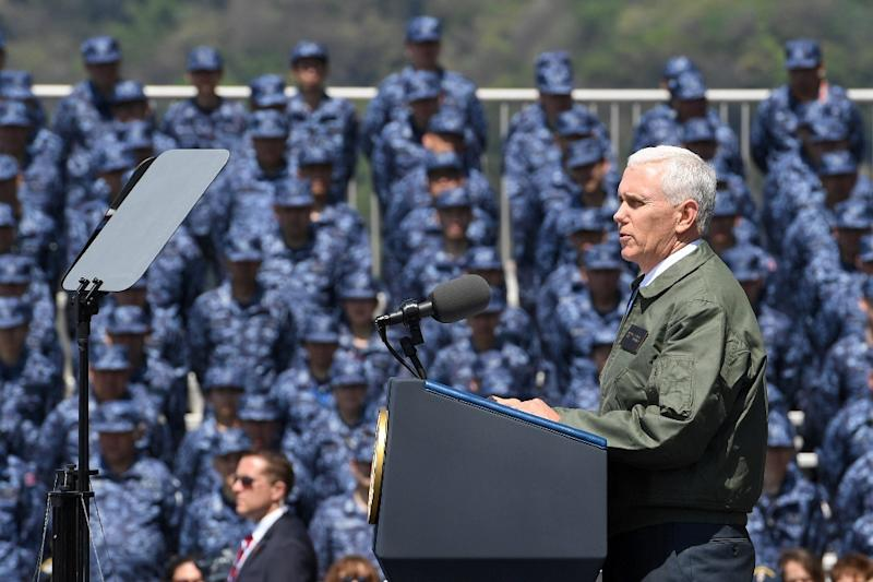 """US Vice President Mike Pence ramped up the rhetoric as he stood on the deck of the USS Ronald Reagan, pledging an """"overwhelming"""" response to any North Korean attack (AFP Photo/Toshifumi KITAMURA)"""