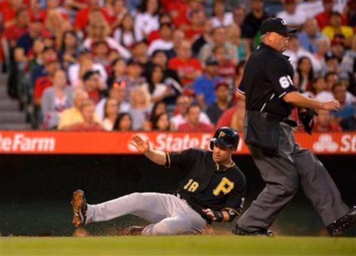 Pittsburgh Pirates' Neil Walker scores on a single by Travis Snider during the fourth inning of their baseball game against the Los Angeles Angels, Saturday, June 22, 2013, in Anaheim, Calif. (AP Photo/Mark J. Terrill)