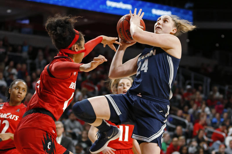 Connecticut guard Anna Makurat (24) shoots over Cincinnati guard Addaya Moore, left, during the second half of an NCAA college basketball game Wednesday, Feb. 26, 2020, in Cincinnati. Connecticut won 105-58. (AP Photo/Gary Landers)