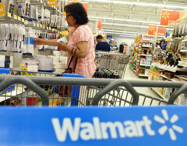 In this Monday, May 14, 2012, shoppers look at merchandise at Walmart in Danvers, Mass. Wal-Mart Stores Inc. reported a 10.1 percent increase in first-quarter profit that beat Wall Street estimates, reported Thursday, May 17, 2012. The world's largest retailer also offered an upbeat profit outlook for the current quarter. (AP Photo/Elise Amendola)